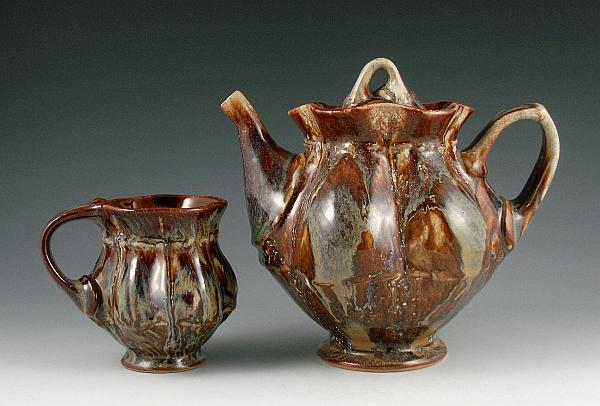 Teapot and Cup with lots of glaze. 2012